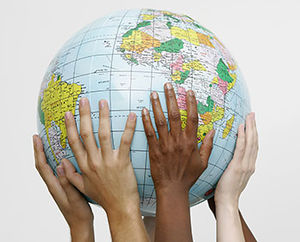 Hands of different persons carrying a globe